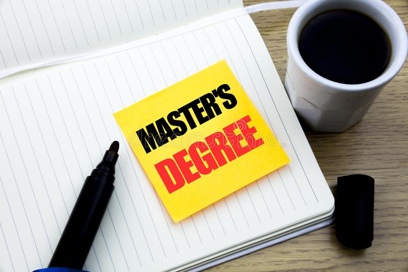 Hand writing text caption inspiration showing Master s Degree. Business concept for Academic Education written on sticky note pape royalty free stock image