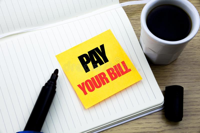 Hand writing text caption inspiration showing Pay Your Bill. Business concept for Payment for Goverment written on sticky note pap. Hand writing text caption royalty free stock photo