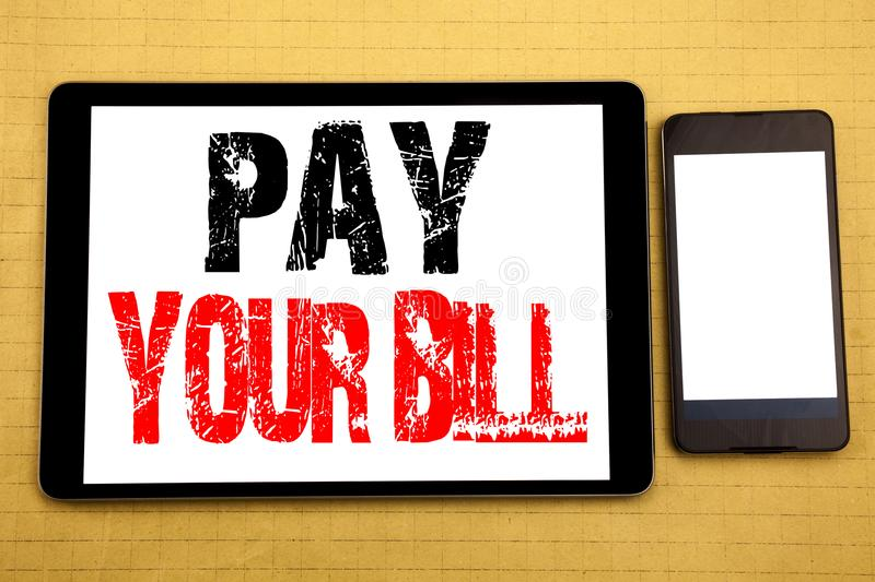 Hand writing text caption inspiration showing Pay Your Bill. Business concept for Payment for Goverment Written on tablet laptop,. Hand writing text caption royalty free stock images