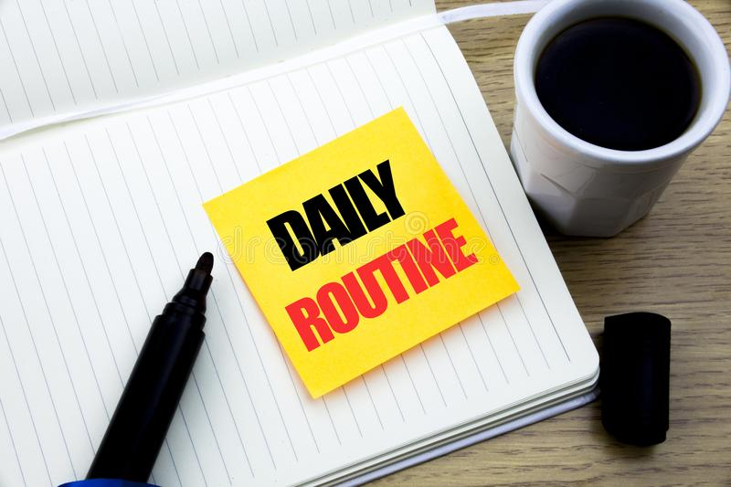 Hand writing text caption inspiration showing Daily Routine. Business concept for Habitual Lifestyle written on sticky note paper, royalty free stock photo