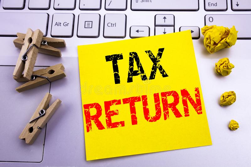 Hand writing text caption inspiration showing Tax Return. Business concept for Accounting Money Return written on sticky note pape. Hand writing text caption stock photography