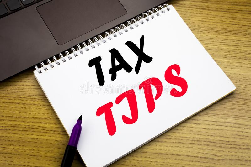 Hand writing text caption inspiration showing Tax Tips. Business concept for Taxpayer Assistance Refund Reimbursement written on n. Otebook book on wooden royalty free stock photography