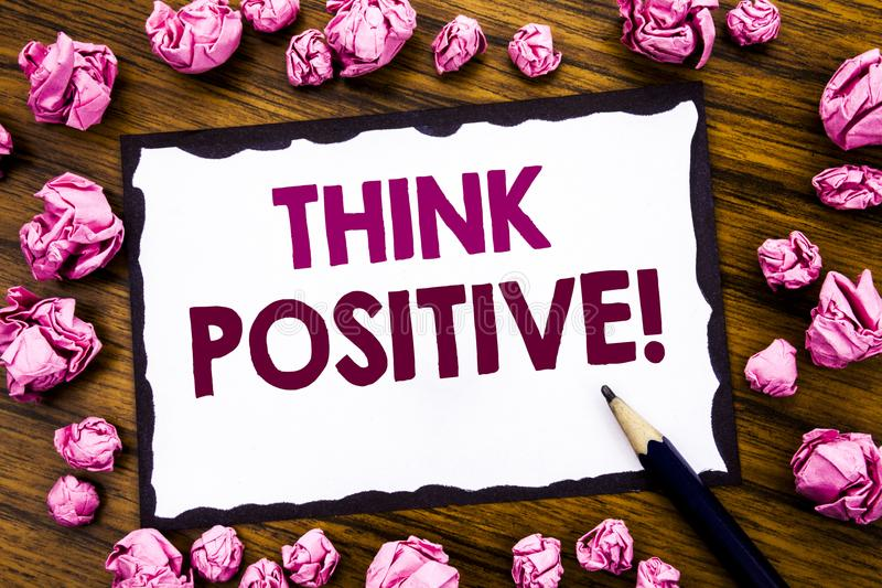 Hand writing text caption inspiration showing Think Positive. Business concept for Positivity Attitude Written on sticky note pape stock image