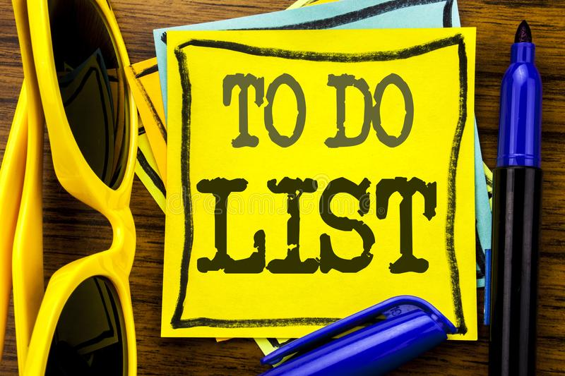Hand writing text caption inspiration showing To Do List. Business concept for Plan Lists Remider Written on sticky note paper, wo royalty free stock images