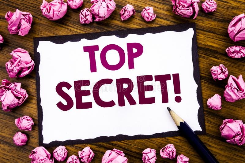 Hand writing text caption inspiration showing Top Secret. Business concept for Military Top Secret Written on sticky note paper, w stock image