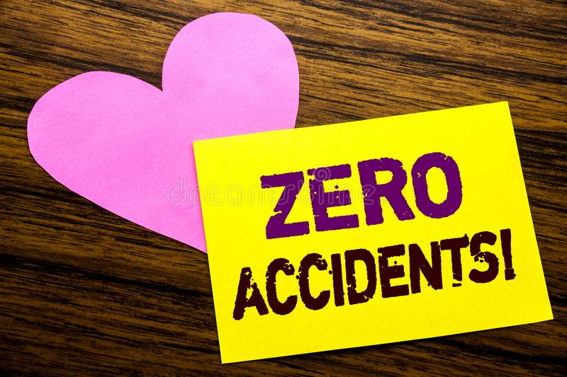 Hand writing text caption inspiration showing Zero Accidents. Business concept for Safety At Work Hazard written on sticky note pa. Per, wooden background. With stock photos