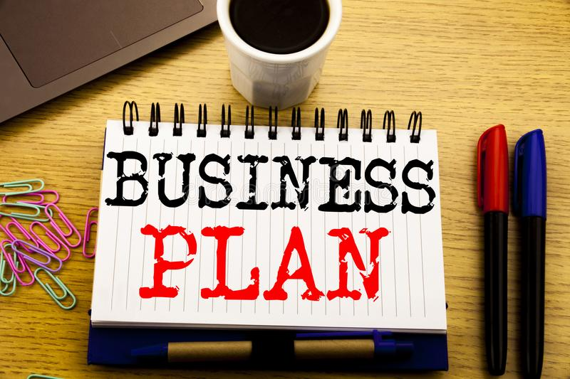 Hand writing text caption showing Business Plan Planning. Business concept for Preparation Project Strategy written on notebook bo. Hand writing text caption stock images
