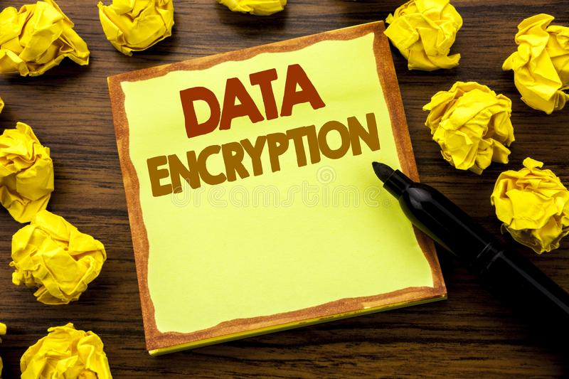 Hand writing text caption showing Data Encryption. Business concept for Information Security Written on sticky note paper, wooden. Background marker folded royalty free stock image