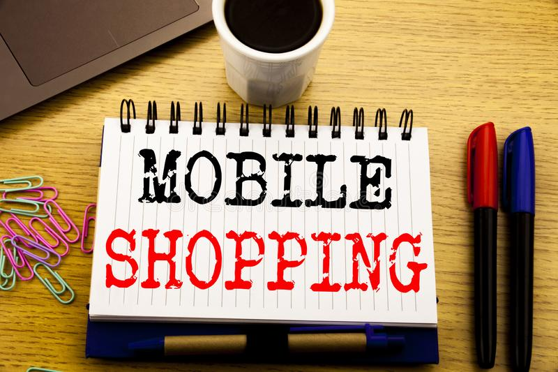 Hand writing text caption showing Mobile Shopping. Business concept for Cellphone online order written on notebook book on the woo. Hand writing text caption royalty free stock image