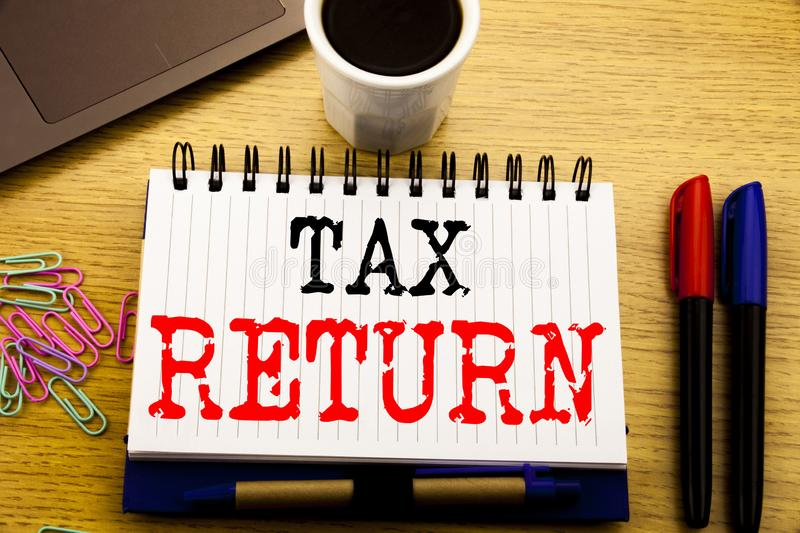 Hand writing text caption showing Tax Return. Business concept for Accounting Money Return written on notebook book on the wooden. Hand writing text caption stock photos