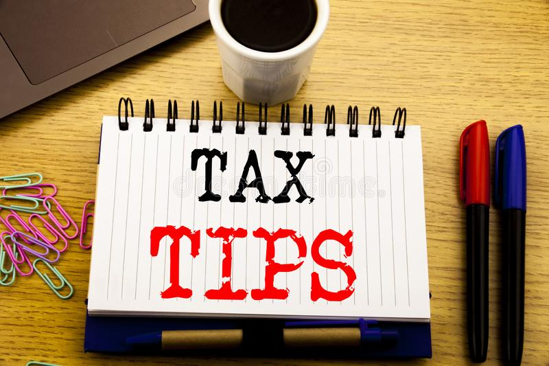 Hand writing text caption showing Tax Tips. Business concept for Taxpayer Assistance Refund Reimbursement written on notebook book. Hand writing text caption royalty free stock image