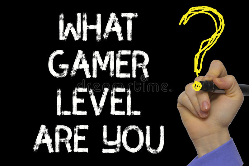 Hand writing the text: What Gamer Level Are You stock photography
