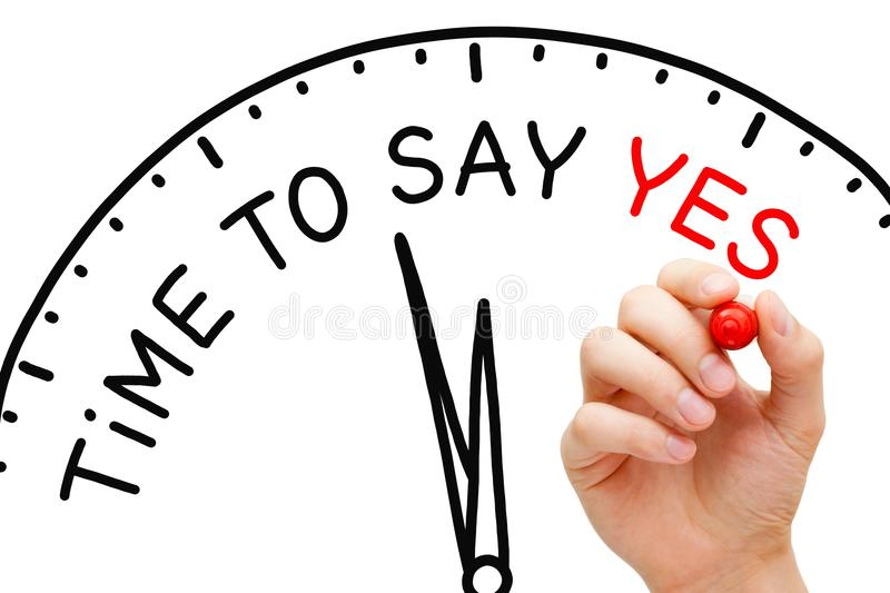 Time To Say Yes Clock Concept. Hand writing Time To Say Yes concept with marker on transparent glass board stock images