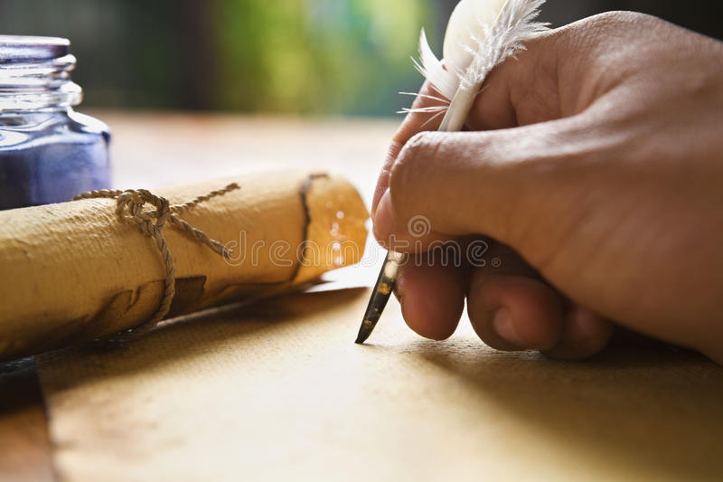 Hand writing using quill pen stock photography