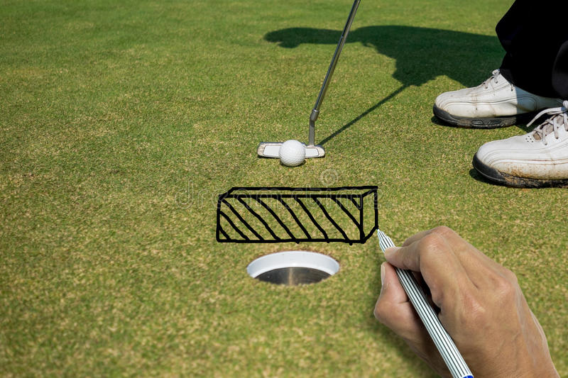 Hand writing wall between golf ball and hole stock images