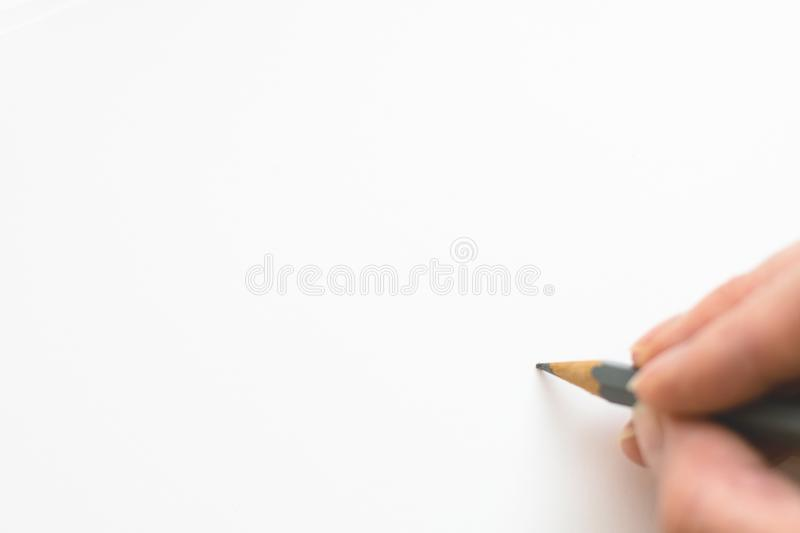 Hand writing on white paper stock images