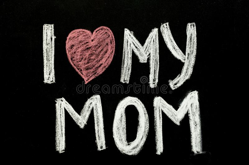 Hand written text `i love my mom` on chalkboard royalty free stock images