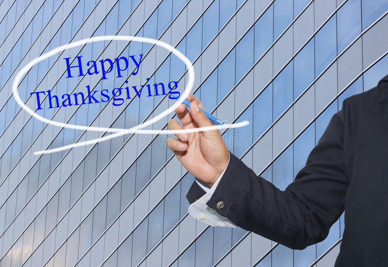 Hand of young businessman write the word Happy Thanksgiving on s royalty free stock images