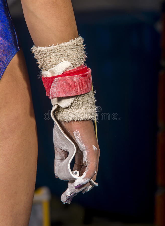 Hand of young gymnast girl with magnesium royalty free stock image