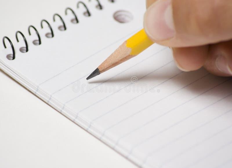 handanteckningsbokblyertspenna arkivfoton