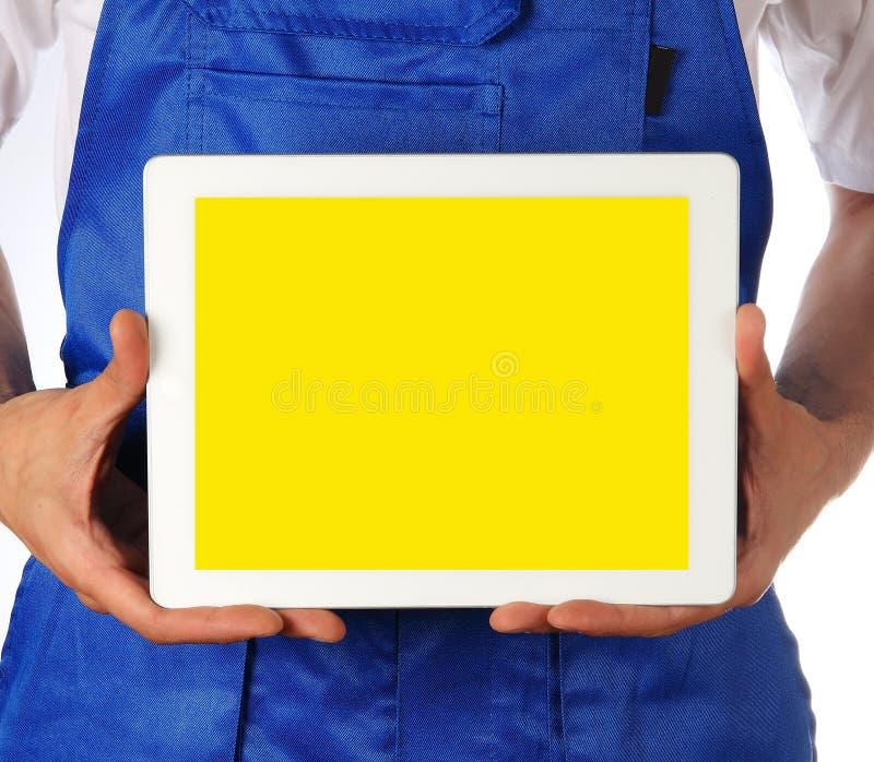 Handarbeidersmens met tablet stock afbeelding