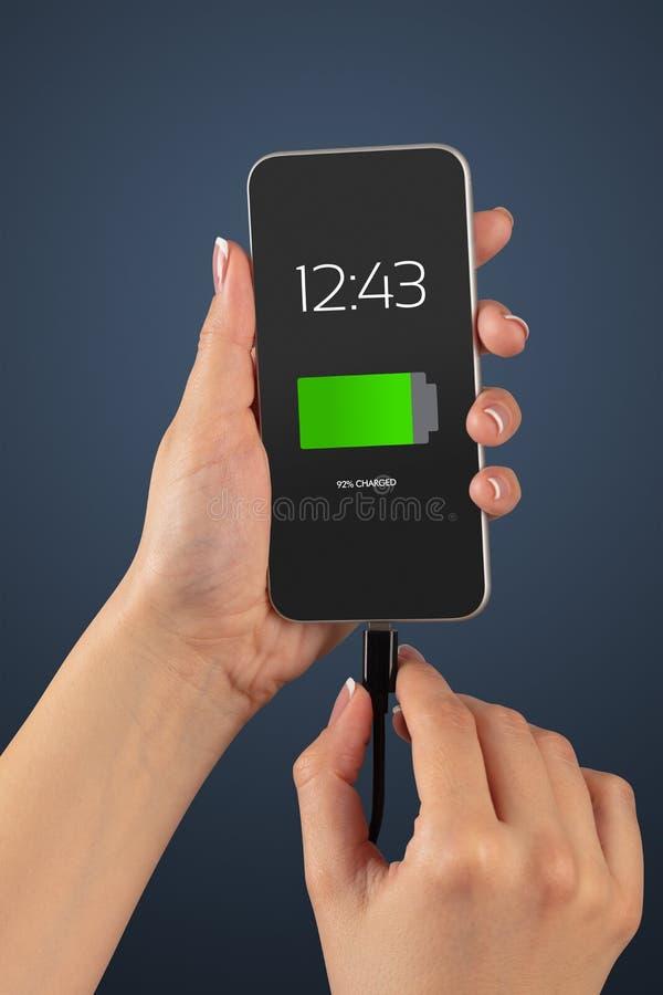 Handaufladungstelefon stockfotos
