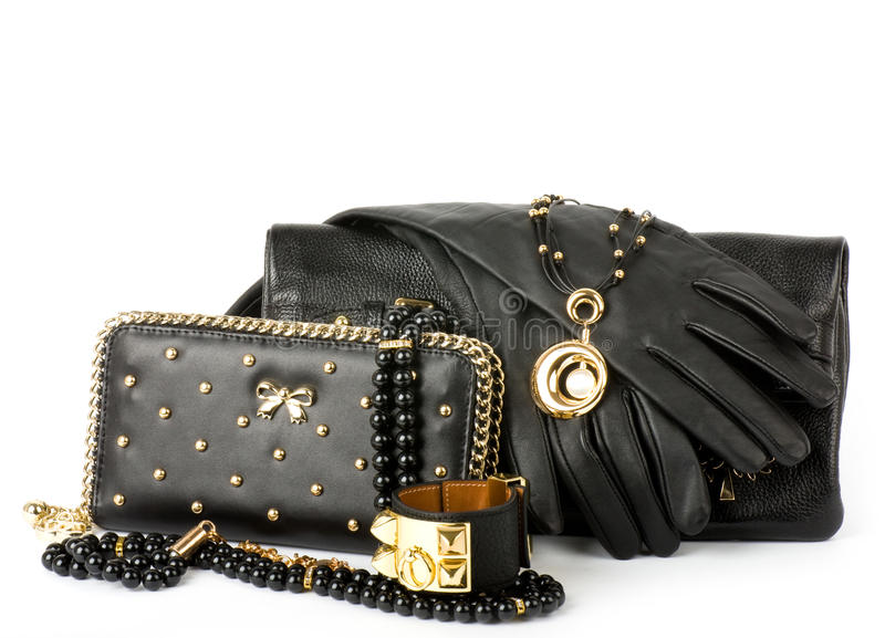 Handbag and golden jewelry royalty free stock photo
