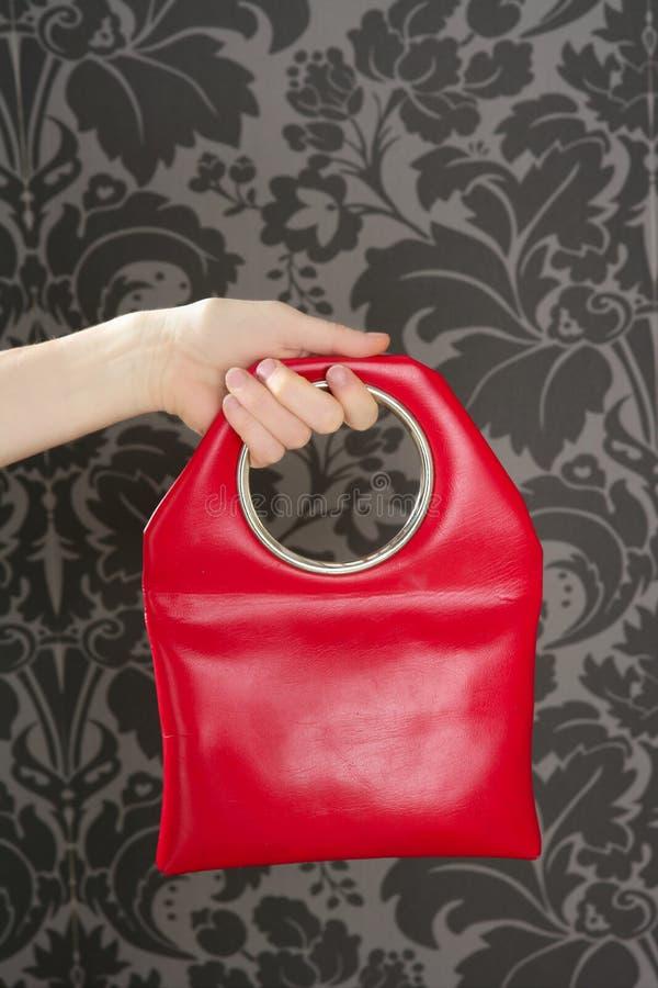 Handbag retro vintage fashion red bag. Red handbag retro vintage fashion bag on sixties wallpaper stock image