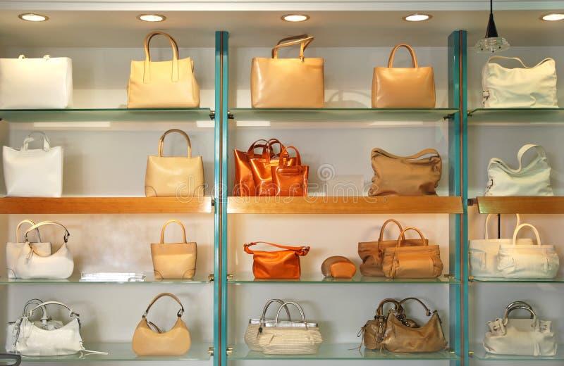 Handbags in the shop stock photos
