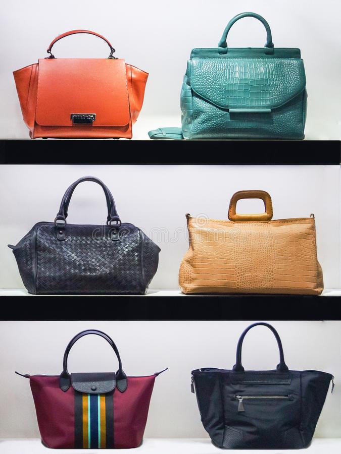 Handbags in the shop window of a fashion boutique stock image
