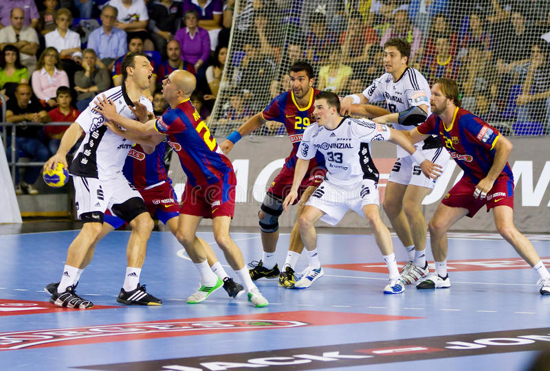 Handball match. BARCELONA - APRIL 24: Some players in action during the handball Champions League match between Barcelona and THW Kiel, final score 27 - 25 royalty free stock image