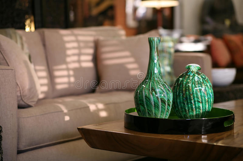 Handblown glass vases in an urban living room. Handblown glass vases on a coffee table in in an urban living room royalty free stock photo
