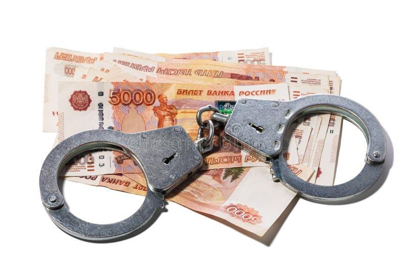 Handbojor på isolerade ryssrubel Begrepp på ämnet av valutabedrägerit royaltyfri bild