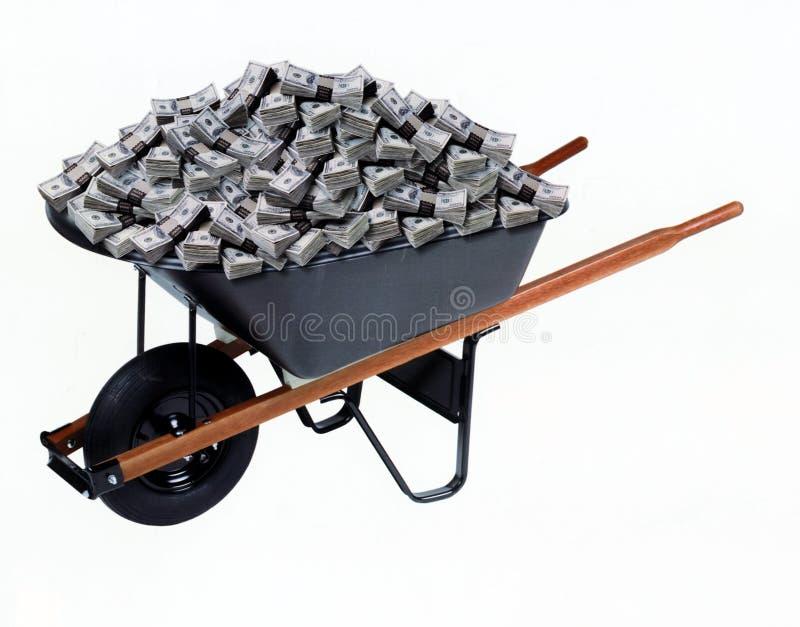 Handcart com dólares enormes do bloco de uma quantidade imagens de stock