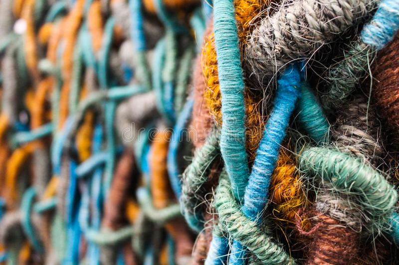 Handcraft piece of art made with string fibers colored stock photos