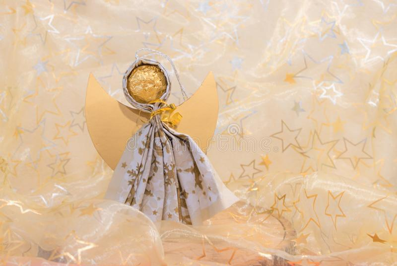 Handcrafted angel, creative work with christmas background royalty free stock photography