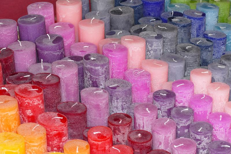 Handcrafted colorful candles in all colors. Lot of handcrafted colorful candles in all colors stock photo