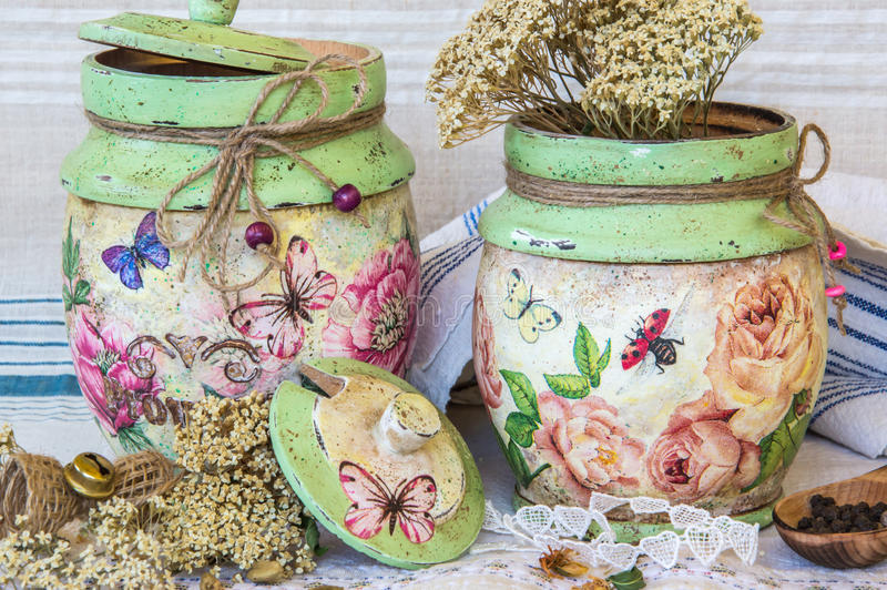 Handcrafted and decoupage hand decorated containers. Decoupage decorated wooden containers on rustic backgruond royalty free stock images