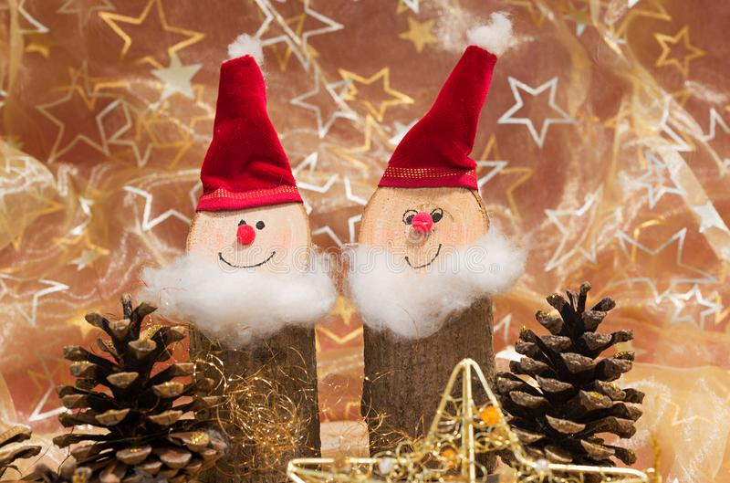 Handcrafted santa gnomes made of wood and christmas background w stock image