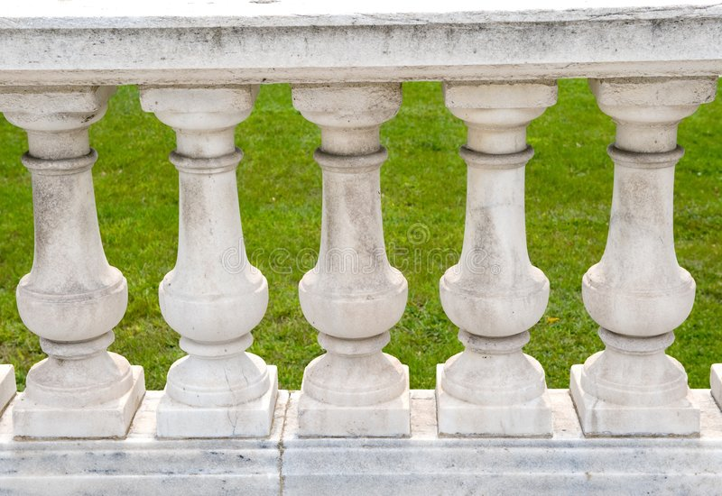 Handcrafted stone pillar railings. An image of handcrafted stone pillar railings royalty free stock image