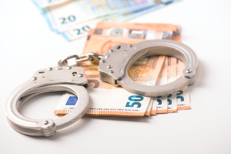 Handcuff en euro geld stock foto's
