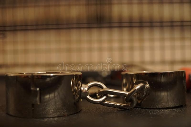 Handcuff fetish shackle fetter bracelet wristband. Handcuff fetish shackle fetter bracelet security wristband irons snap shackled arms stock image