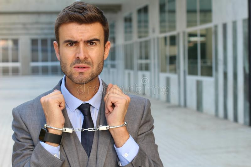 Handcuffed businessman with copy space royalty free stock image