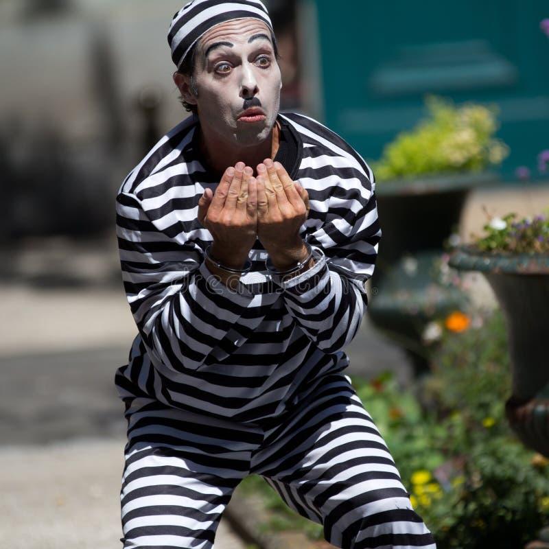 Handcuffed clown royalty free stock image