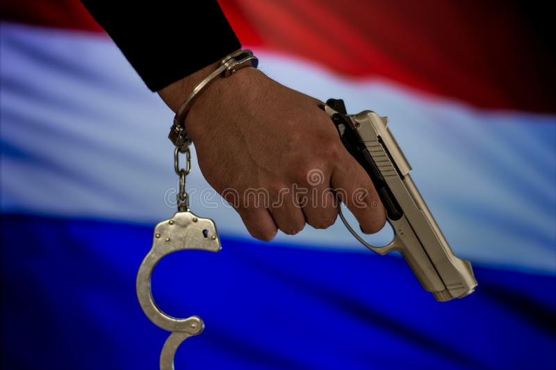 Handcuffed hand in front of the country flag. crime concept royalty free stock photography