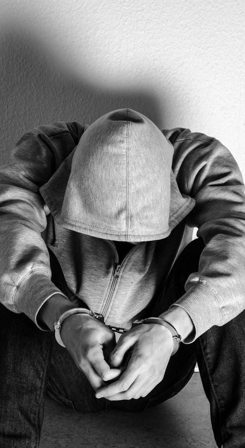 Handcuffed Person Stock Photo