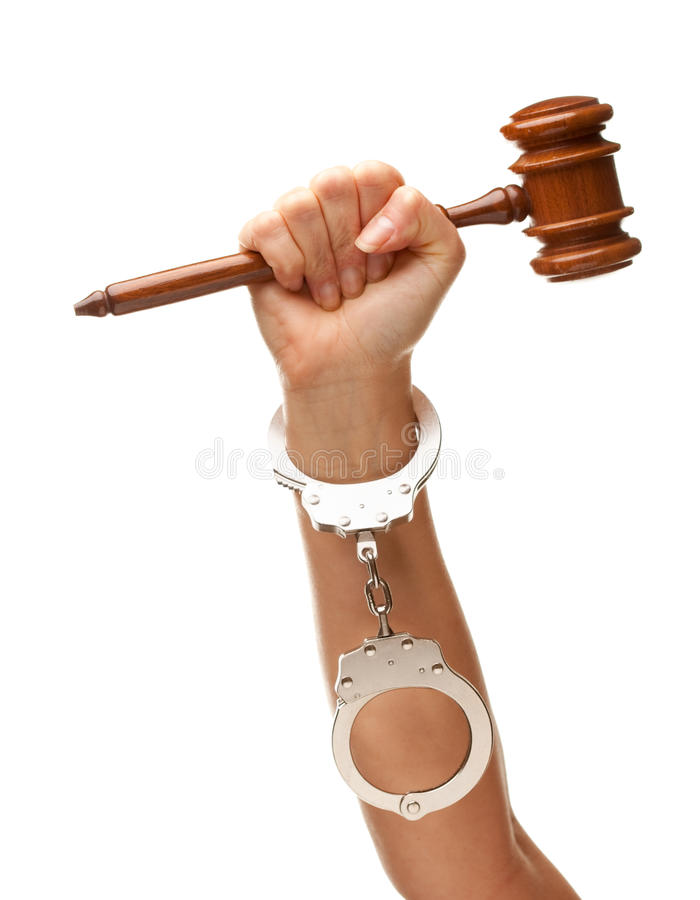 Handcuffed Woman Holding Wooden Gavel on White stock image