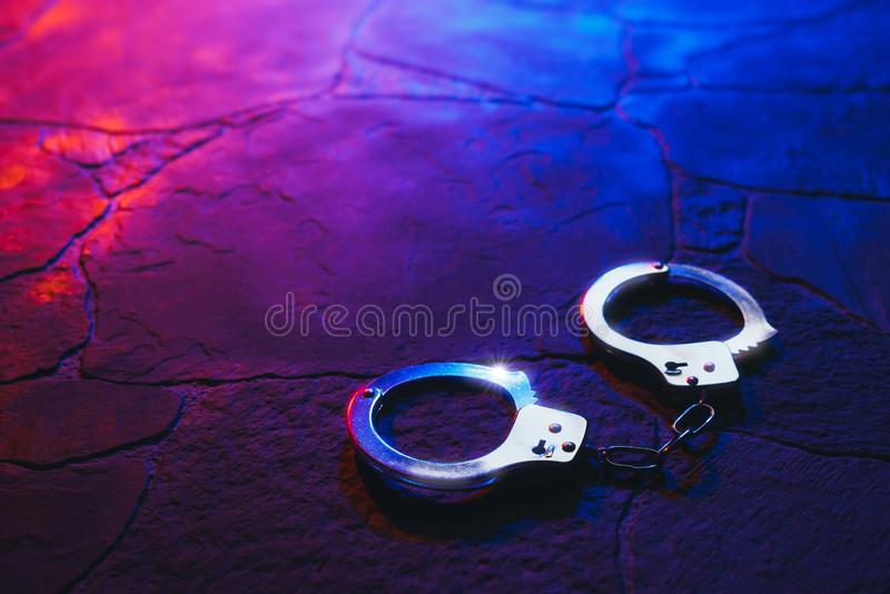 Handcuffs on the floor at night stock photos