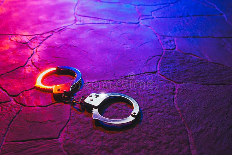 Handcuffs on the floor at night royalty free stock photo