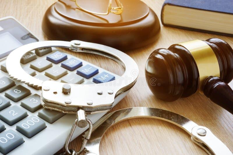Handcuffs, gavel and calculator. Financial fraud. stock image